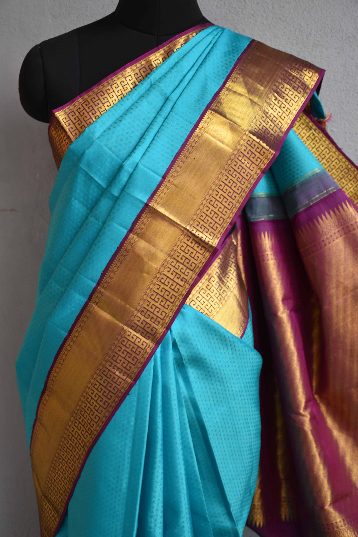 Turquoise blue kancheepuram silk saree with purple korvai border 3