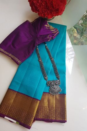 Turquoise blue kancheepuram silk saree with purple korvai border