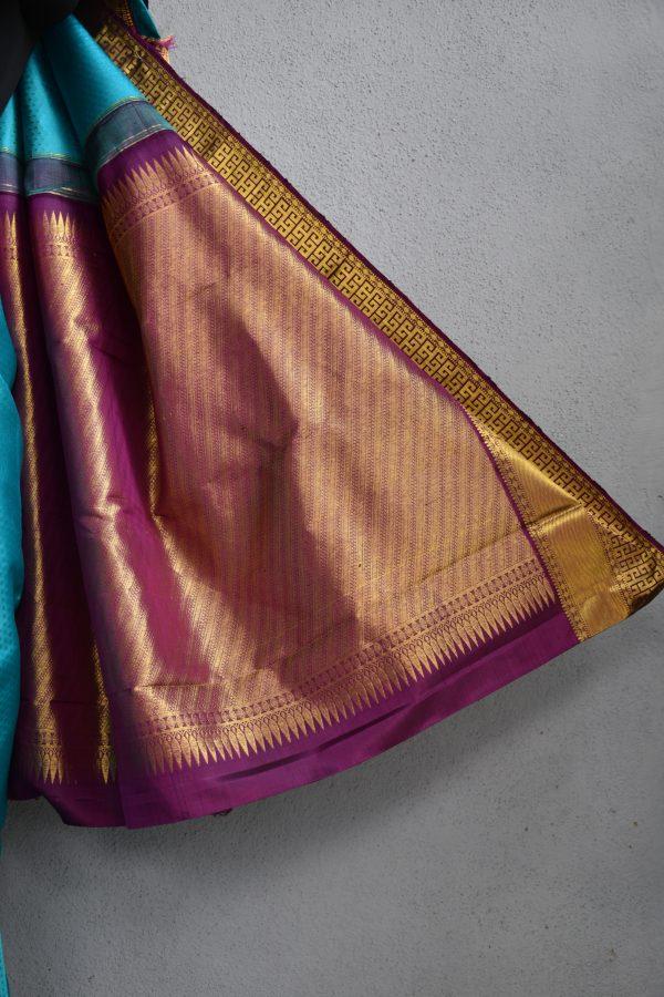 Turquoise blue kancheepuram silk saree with purple korvai border 4
