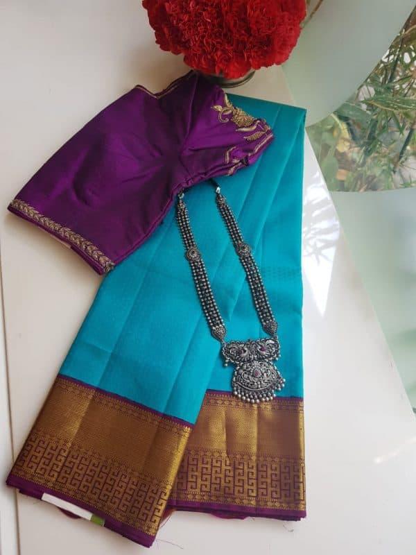 Turquoise blue kancheepuram silk saree with purple korvai border