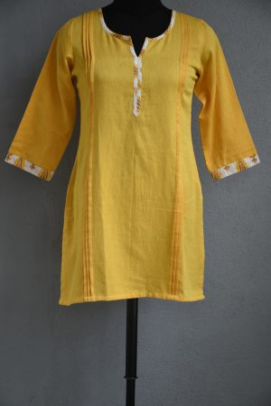 Yellow cotton short kurti with printed trims