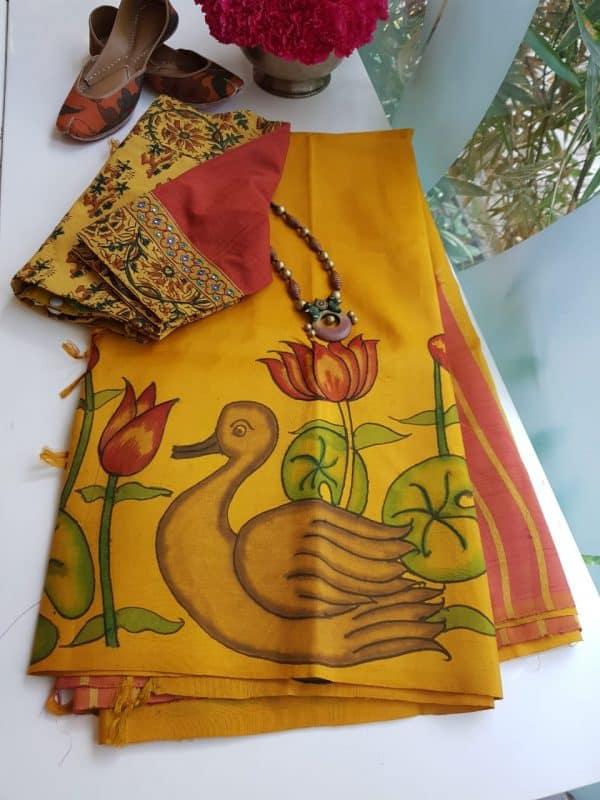 mustard and peach stripes kanchi silk saree with kalamkari