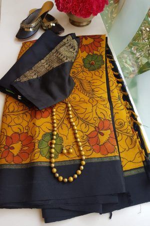 mustard kanchi silk saree with black korvai border and kalamkari