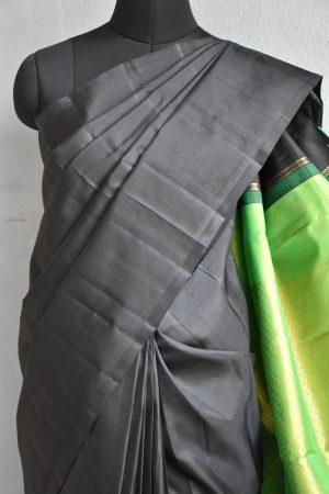 plain black kanchi silk saree with green brocade pallu 2