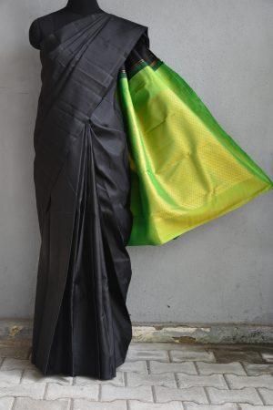 plain black kanchi silk saree with green brocade pallu
