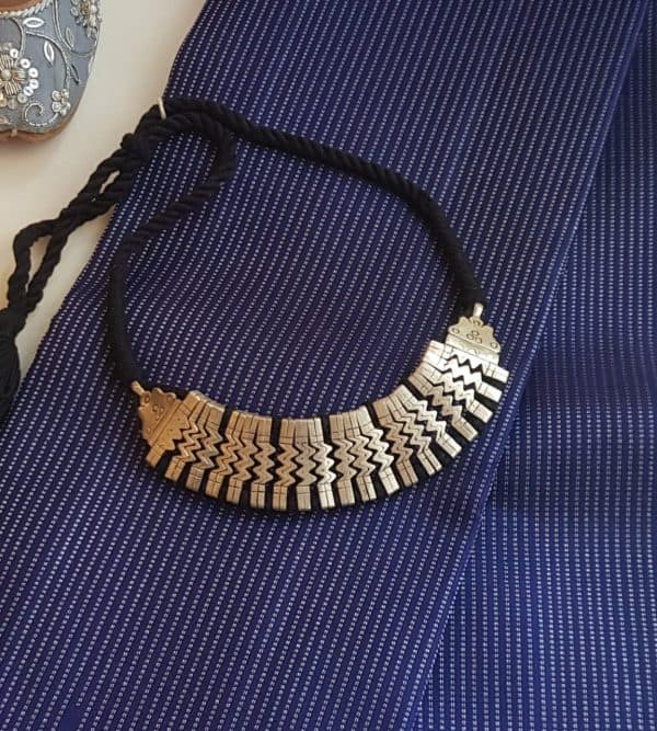 silver choker on black thread