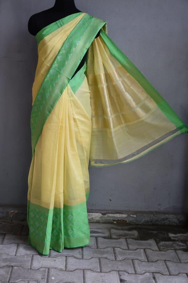 yellow chandheri saree with green zari border 1