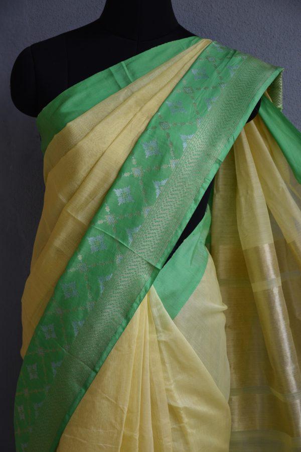 yellow chandheri saree with green zari border 3
