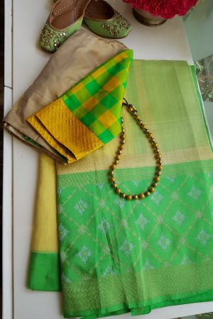 yellow chandheri saree with green zari border