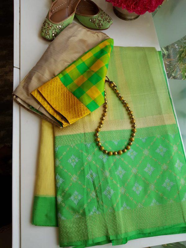 yellow chandheri saree with green zari border