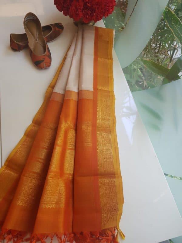 Beige kanchi silk dupatta with orange border