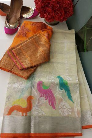 Cream real zari kota saree with multi colour birds
