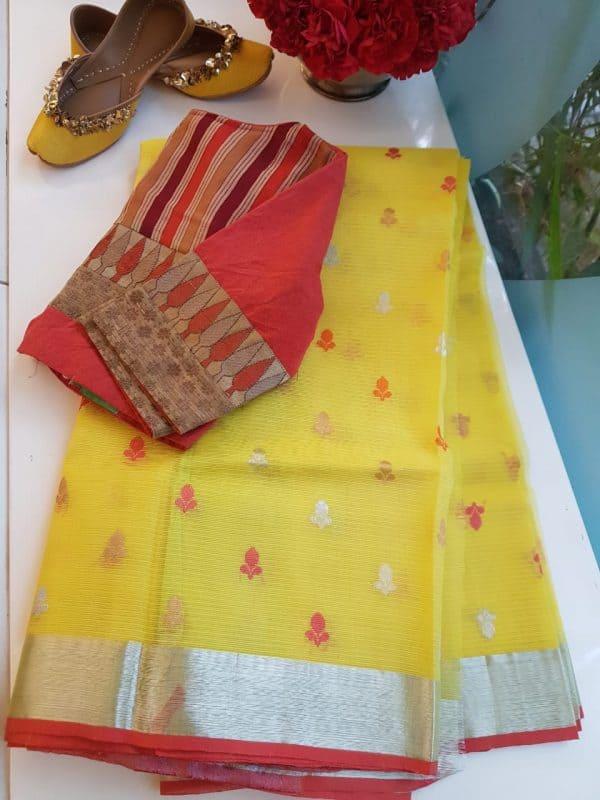 Yellow real zari kota saree with pink border
