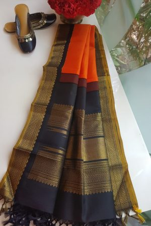 Orange kanchi silk dupatta with black korvai border