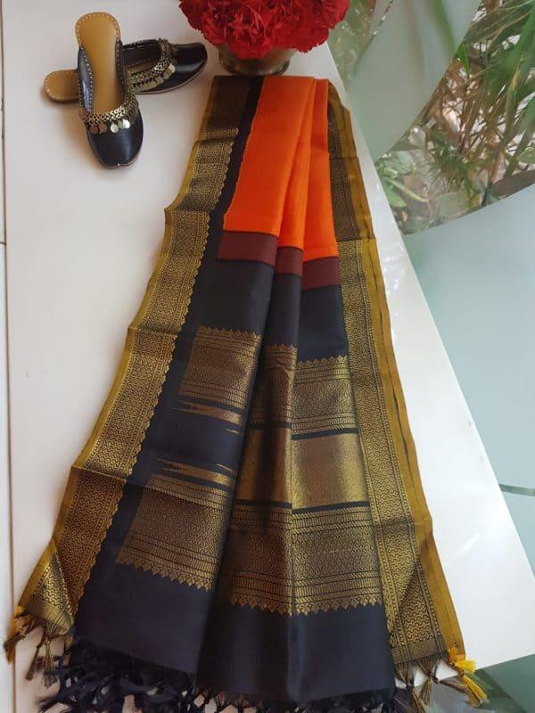 Orange kanchi silk dupatta with black korvai border