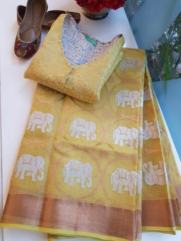 Pale yellow real zari kota saree with elephants