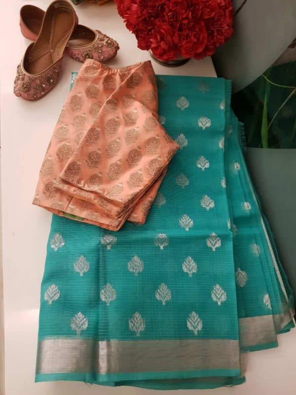 Teal green real zari kota saree with silver zari