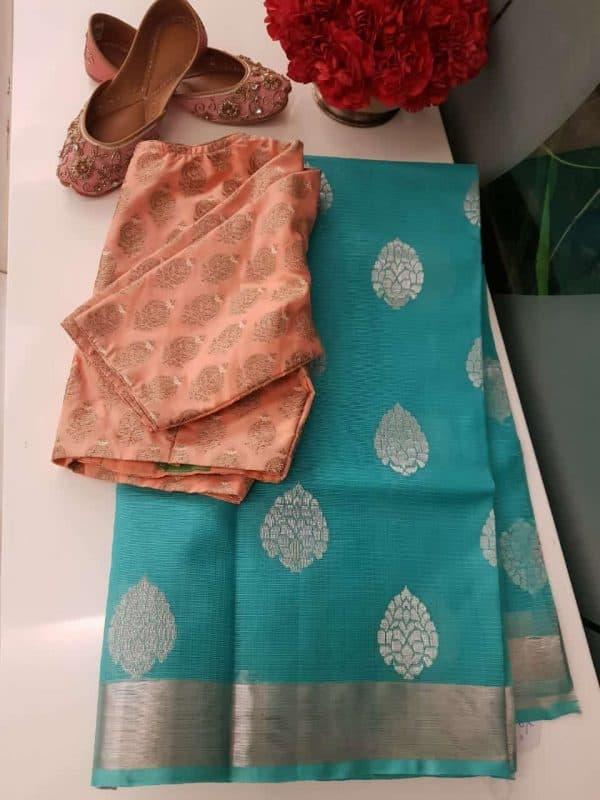 Turquoise blue real zari kota saree with silver buttis
