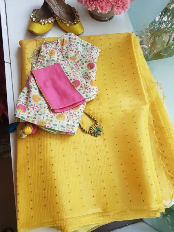 Yellow organza sequins saree