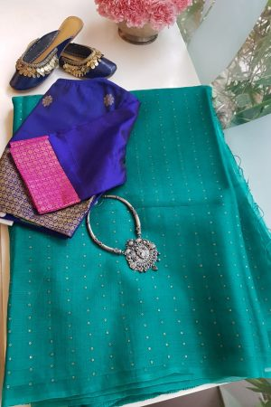 dark teal woven organza saree