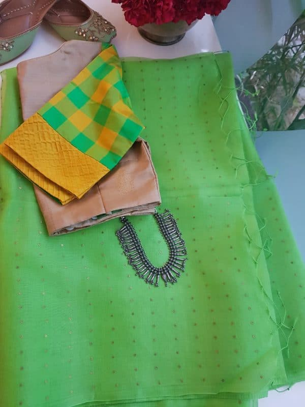 parrot green woven organza saree