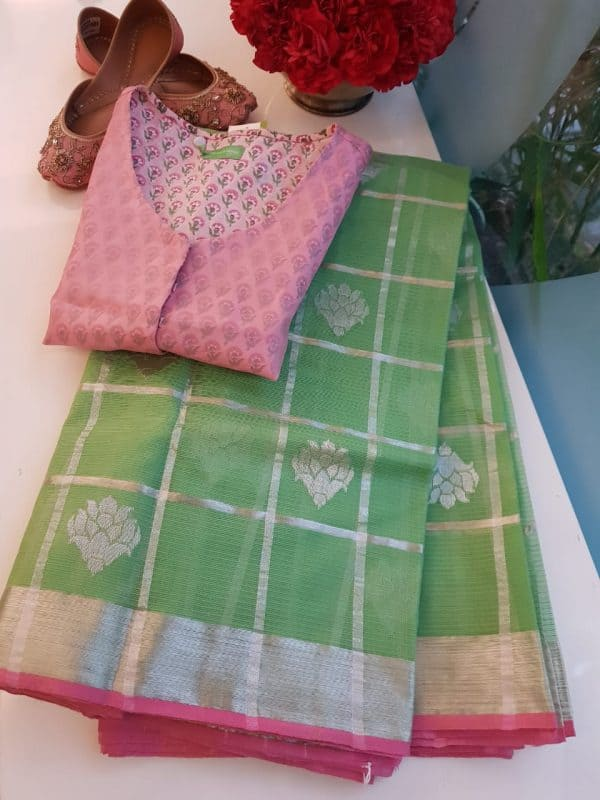 sea green real zari kota saree with pink edge