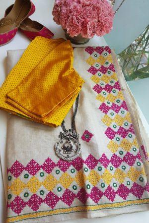 Beige kutch work tussar saree