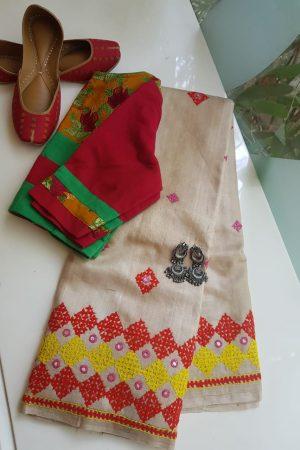 Beige tussar kutch work saree