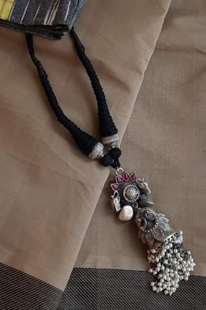 Black rope necklace with silver pendant