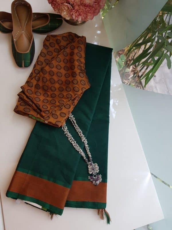 Bottle green kanchi cotton saree with rust border