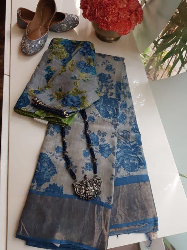 Grey and blue floral print zari border tussar saree