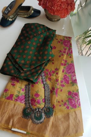 Mustard and pink floral print zari border tussar saree