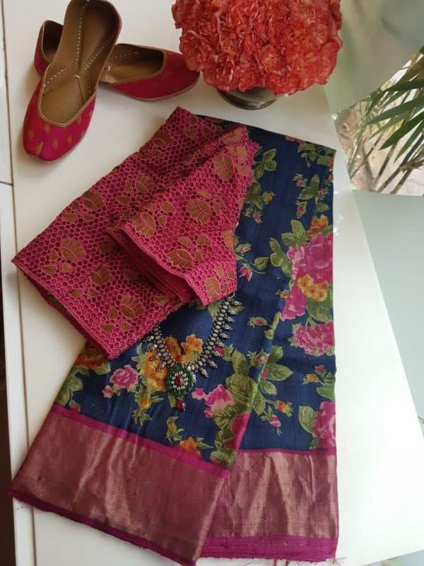Navy blue tussar saree with pink zari border and floral prints