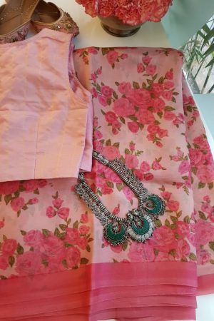 Pink organza saree with floral prints