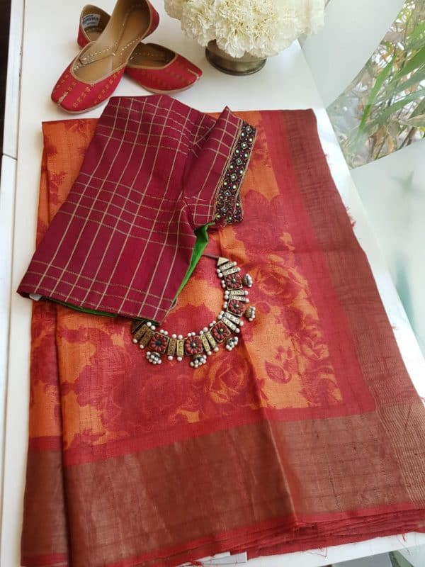 Red and orange floral print zari border tussar saree