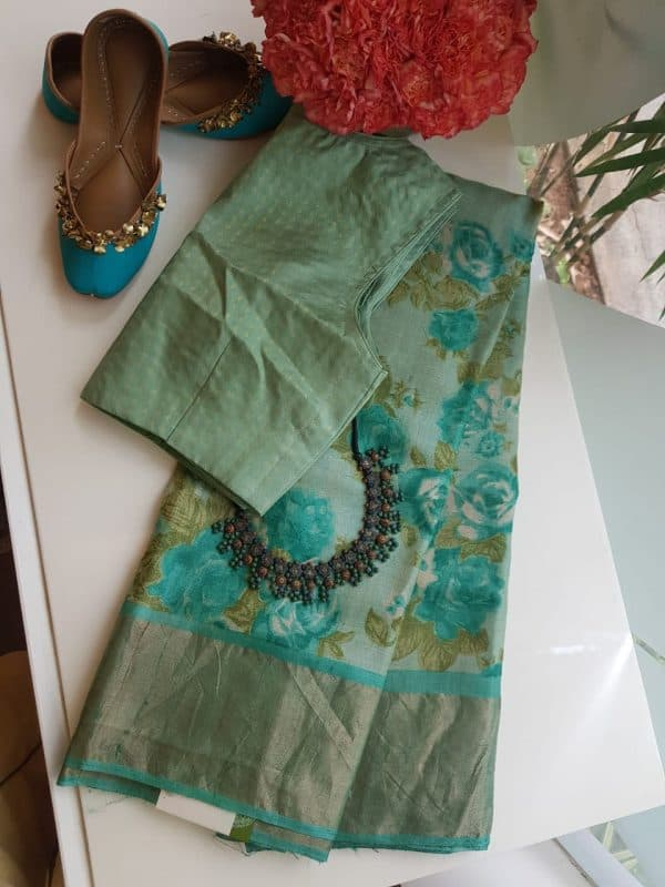 Teal green with floral prints zari border tussar saree