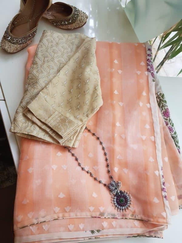 Peach organza saree with floral prints
