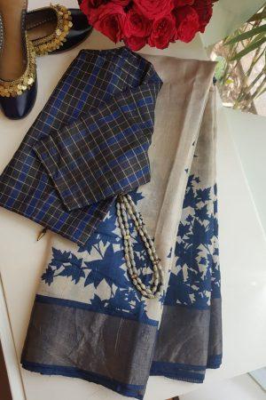 Beige tussar saree with blue maple leaf print and zari border