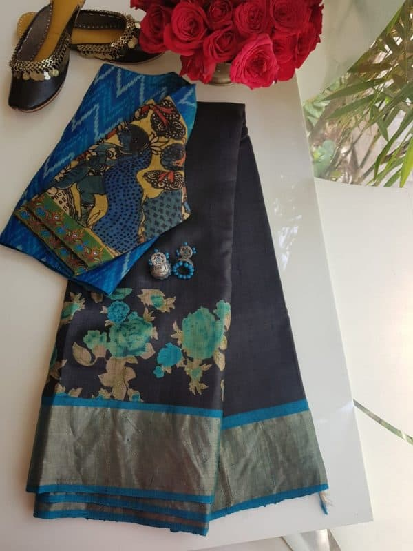 Black zari border tussar saree with blue floral print
