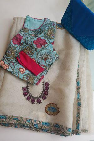 Cream organza saree with kalamkari applique