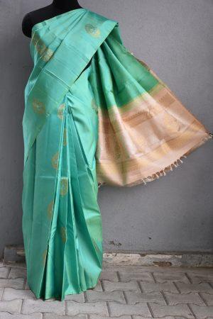 Mint green kanchi silk saree with ikat weave 1