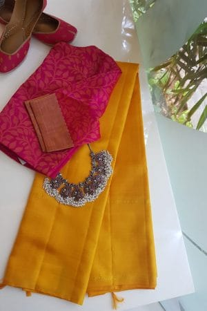Mustard kanchi silk saree with peach pallu