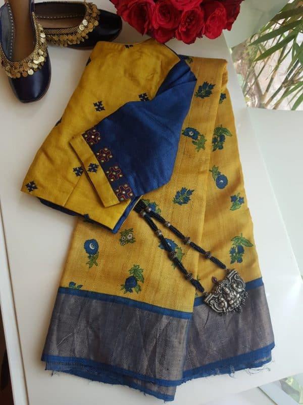 Yellow blue flower print zari border tussar saree