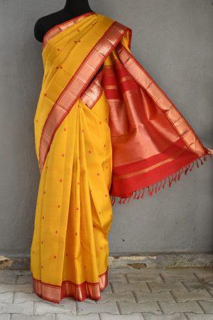 Yellow with copper zari border kanchi silk saree