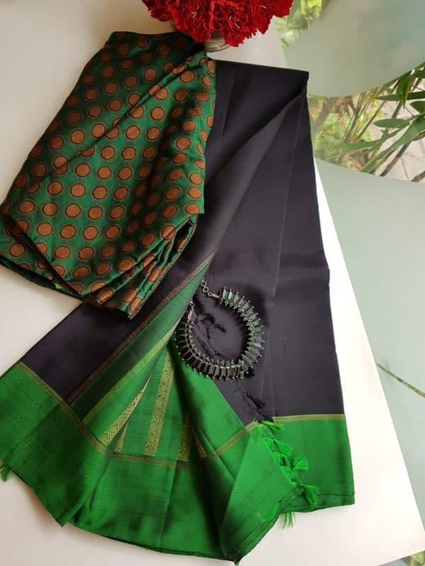 black kanchi silk saree with green brocade pallu