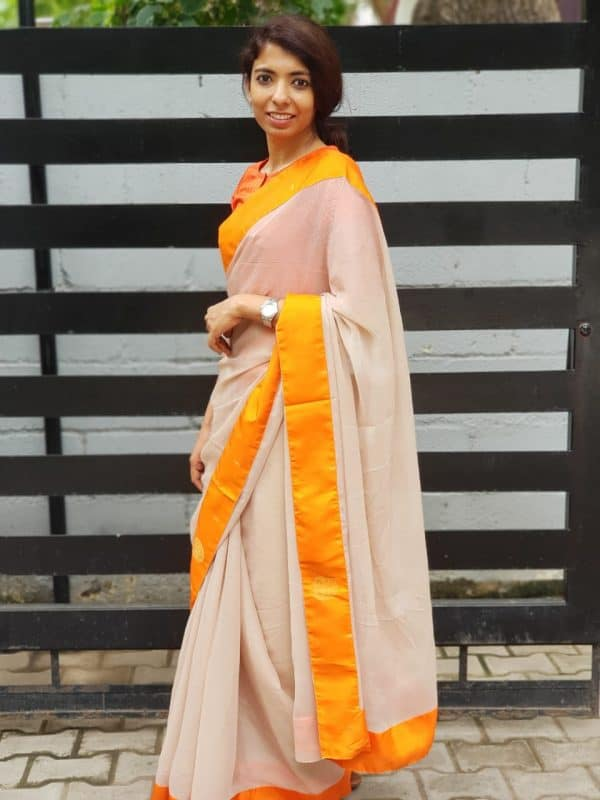 Beige chiffon saree with orange kanchi silk border 1