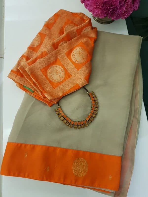 Beige chiffon saree with orange kanchi silk border