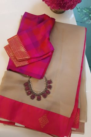Beige chiffon saree with pink kanchi silk border