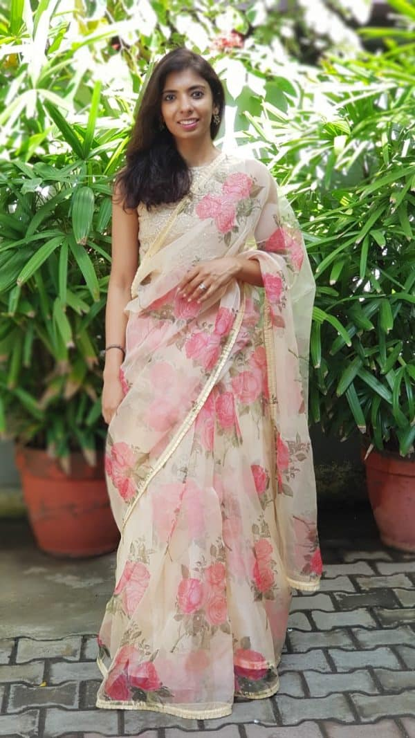 Cream and peach floral printed organza saree
