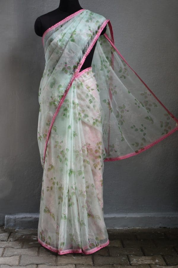 Pale green floral printed organza saree